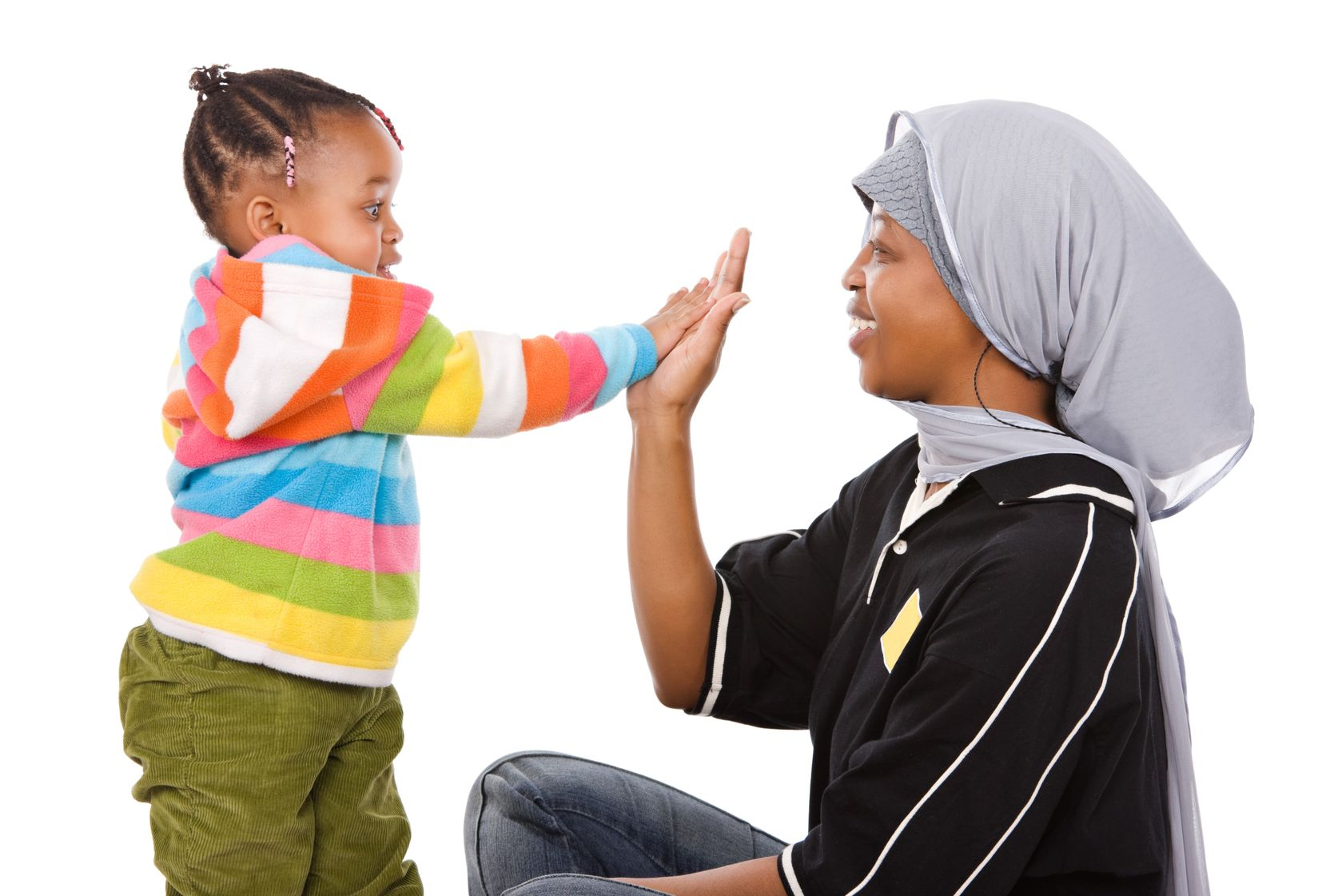 4118007 - muslim mother high five with her cute little african girl